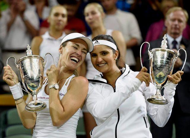 Hingis a conquis son 10e titre majeur en double dames, son 17e au total en Grand Chelem. [Facundo Arrizabalaga - Keystone]