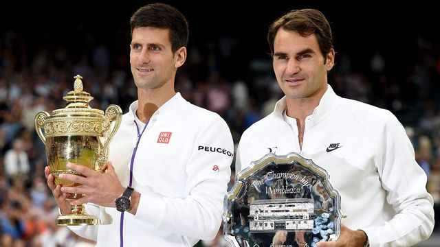 12 juillet, Londres. Novak Djokovic gagne une troisième couronne à Wimbledon en dominant Roger Federer 7-6 6-7 6-4 6-3. Le Serbe prive le Bâlois d'un huitième sacre sur le gazon londonien. [Andy Rain - Keystone]