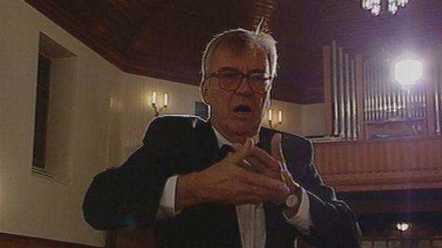 Portrait du chef de choeur André Charlet en 1996. [RTS]