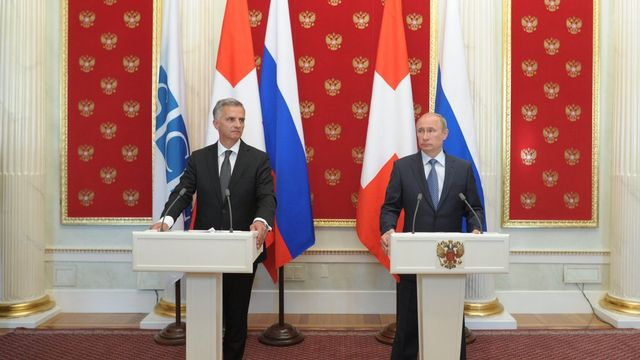Didier Burkhalter a rencontré Vladimir Poutine à Moscou le 7 mai. [Alexey Druginyn - EPA/RIA NOVOSTI/Keystone]