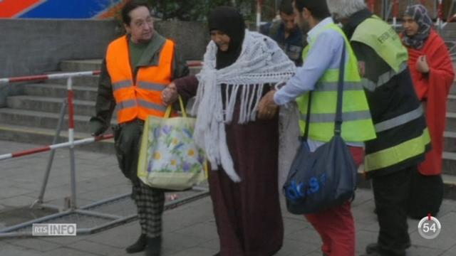 En Allemagne, des milliers de réfugiés arrivent en gare de Munich [RTS]