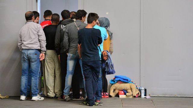 Migrants à Erfurt, en Allemagne, mardi. [Martin Schutt - EPA/Keystone]