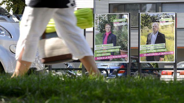 Affiches électorales à Genève. [Martial Trezzini - Keystone]