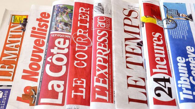 Quelques titres de la presse romande. [Dominic Favre - Keystone]