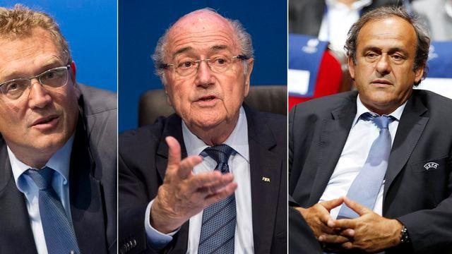 Jérôme Valcke, Sepp Blatter et Michel Platini ont été suspendus. [Keystone]