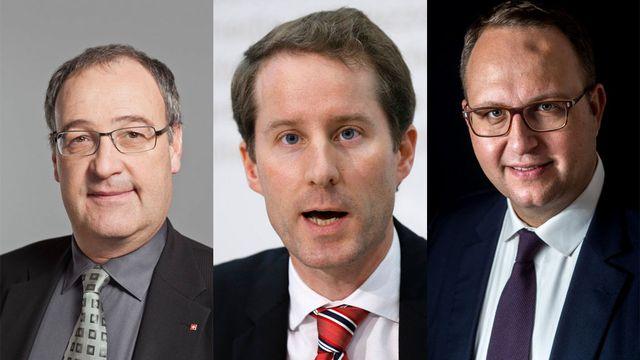 Les trois candidats présentés par le groupe UDC: Guy Parmelin, Thomas Aeschi et Norman Gobbi (de g. à dr.). [Keystone]