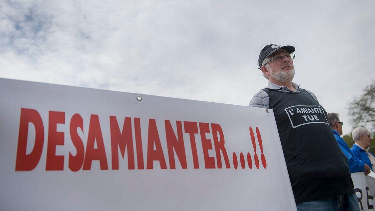 Manifestation de soutien aux victimes de l'amiante en mai 2013 à Genève. [Keystone]