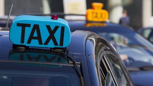 Les chauffeurs de taxis traditionnels montent à nouveau au front contre Uber. [Salvatore Di Nolfi - Keystone]