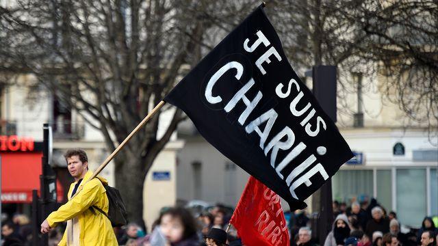 """""""Je suis Charlie"""": le slogan qui a émergé après les attentats contre le journal satirique français est devenu un symbole pour 2015. [MARTIN BUREAU - AFP]"""