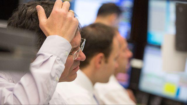 Des traders du stock exchange à Francfort, ce 7 janvier 2016. [AFP]