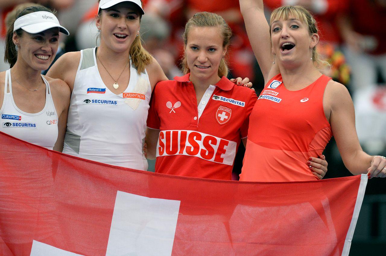 Martina Hingis, Belinda Bencic, Viktorija Golubic et Timea Bacsinszky peuvent avoir le sourire. [Walter Bieri - Keystone]