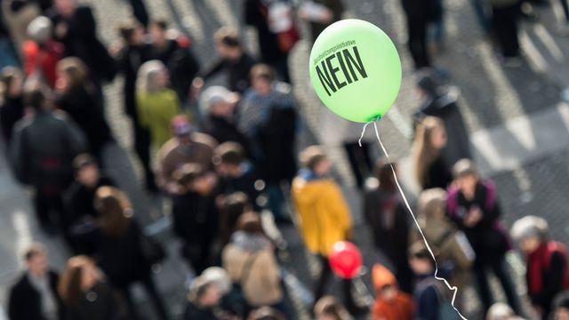 Les Suisses ont voté en masse ce dimanche, rejetant l'initiative de l'UDC à près de 60%. [Ennio Leanza - Keystone]