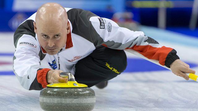 Skip de l'équipe canadienne, Kevin Koe a décroché son deuxième titre mondial à Bâle. [Georgios Kefalas - Keystone]