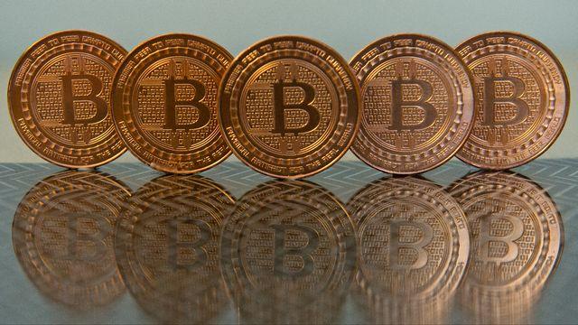"""La technologie """"blockchain"""" est issue de la monnaie virtuelle bitcoin. [Karen Bleier - AFP]"""