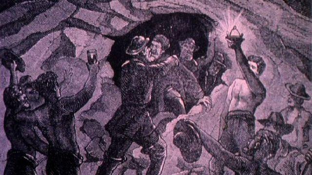 Rencontre des équipes d'ouvriers des deux chantiers du premier tunnel ferroviaire du Gothard. [RTS]