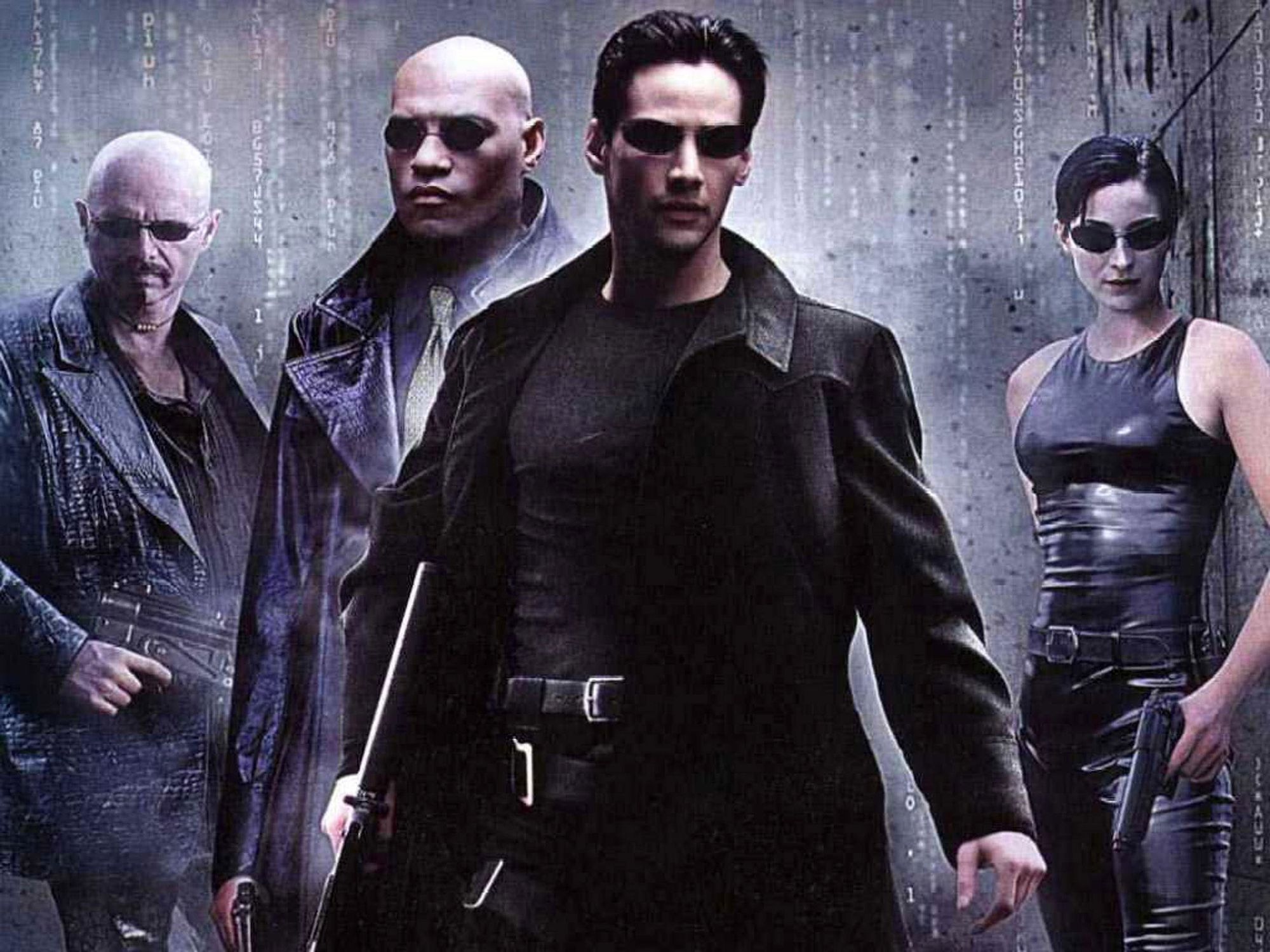 "Joe Pantoliano, Laurence Fishburne, Keanu Reeves, Carrie-Anne Moss dans ""Matrix"" (1999)."
