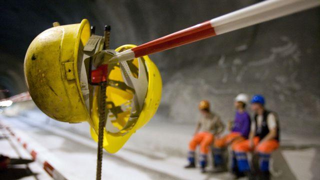 De nombreuses personnes ont oeuvré à la réalisation du tunnel du Gothard. [Martin Ruetschi - Keystone]