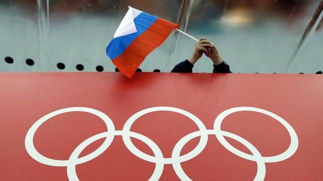 Les athlètes russes repêchés participeront aux JO sous bannière russe. [David J. Phillip - Keystone]