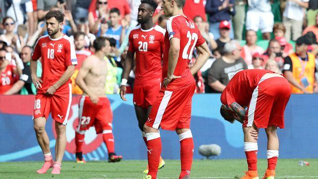 Les joueurs suisses se sont battus jusqu'au bout, en vain. [Valery Hache - AFP]