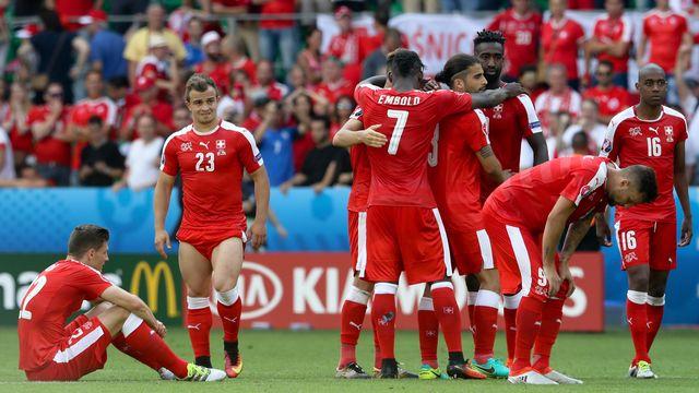 Toute la tristesse des Suisses après leur défaite face à la Pologne. [Andreas Pranter  - EQ]