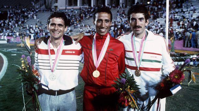 L'athlète suisse Markus Ryffel (à gauche), médaille d'argent du 5000 mètres aux Jeux olympiques de Los Angeles en 1984, derrière le Marocain Saïd Aouita. [Keystone]