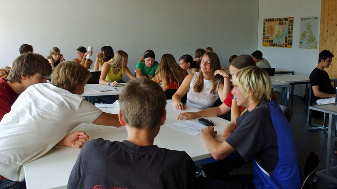 Cours de français dans une classe de Wil, en Thurgovie. [Regina Kühne - Keystone]