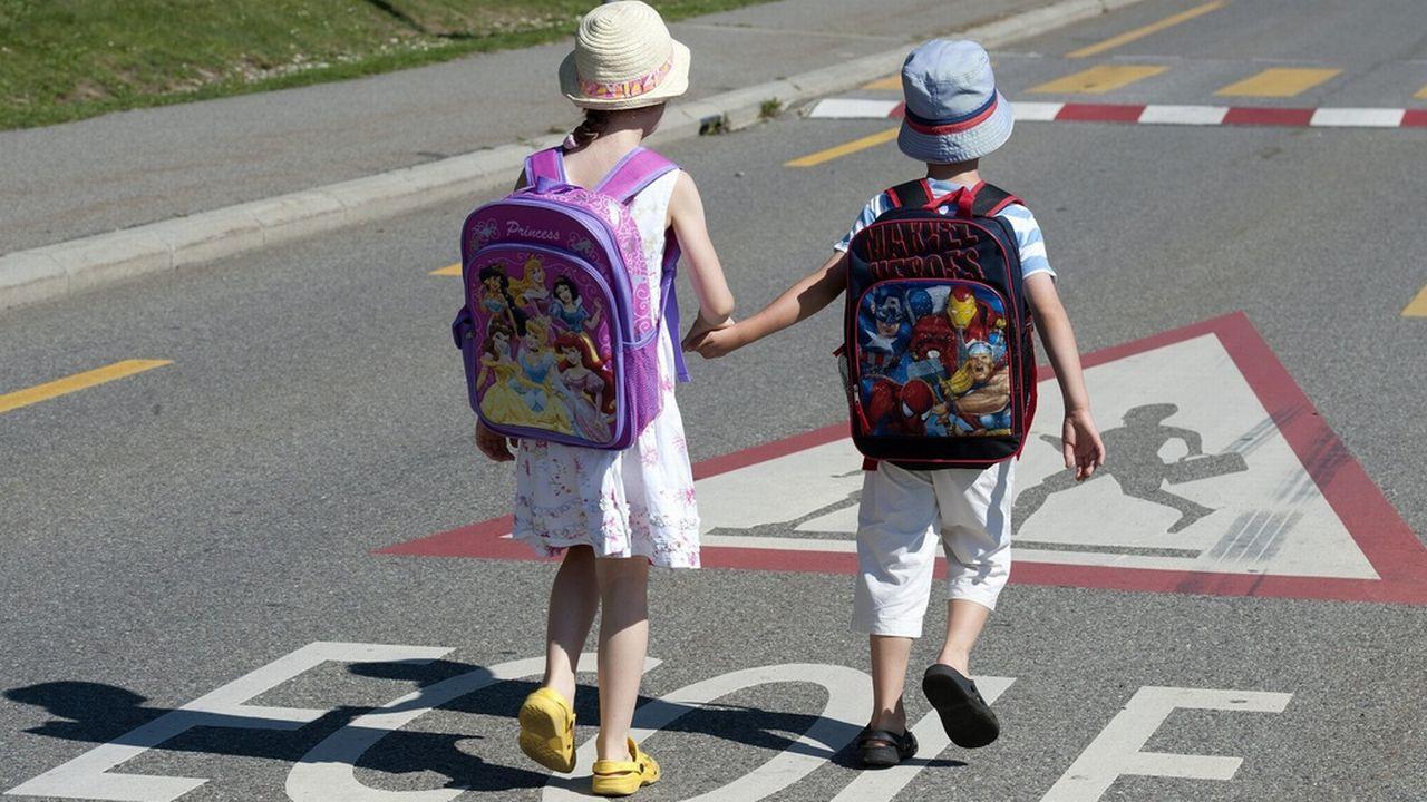 Des élèves vaudois sur le chemin de l'école. dominic favre Keystone [Dominic Favre - Keystone]