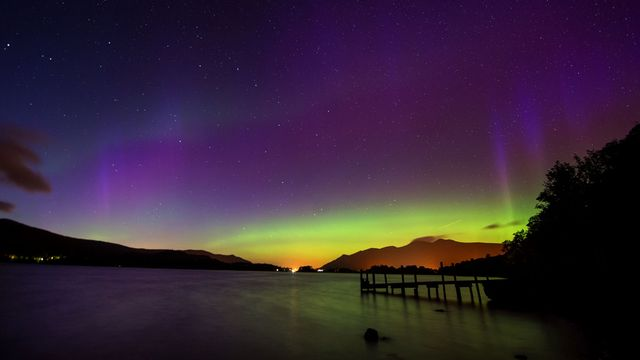 Une aurore boréale est un phénomène lumineux caractérisé par des voiles extrêmement colorés dans le ciel nocturne. [Owen Humphreys - Keystone]