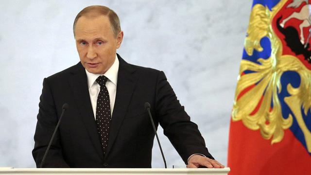 Vladimir Poutine vise les fonctionnaires mais pas son ministre des Sports. [Ivan Sekretarev - AP/Keystone]