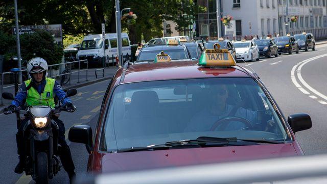 Manifestation des chauffeurs de taxis genevois en juin dernier. [Salvatore Di Nolfi - Keystone]