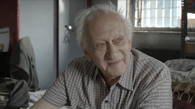 """Dr Jack dans sa chambre monastique. Une scène du film """"Docteur Jack. Un homme, une vie, un combat"""". [drjack.world]"""