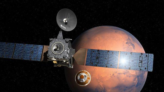 Image artistique de la sonde ExoMars et du petit atterrisseur Schiaparelli. [D. Ducros - ESA/AP/Keystone]