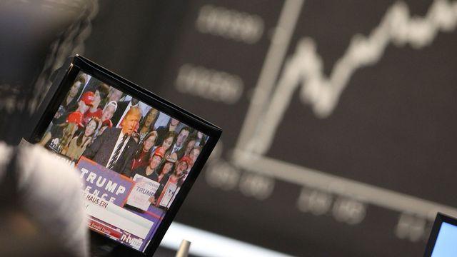 La Bourse de New York a ouvert en oscillant entre baisse minime et légère hausse. [Daniel Roland - AFP]