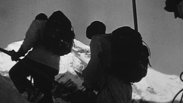 Colonne de sauvetage se rendant sur le lieu de l'accident du Dakota, 1946. [RTS]
