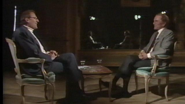 Kirk Douglas sur le plateau de Spécial Cinéma en 1989. [RTS]