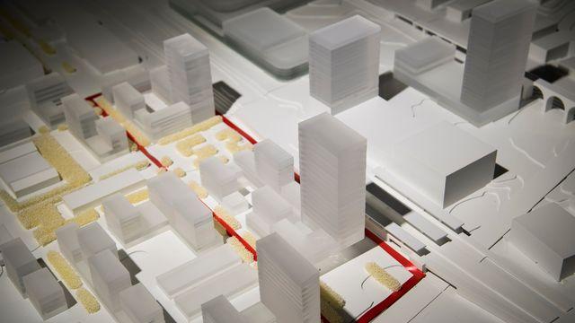 """Vue de la maquette de l'association """"Malley Demain"""" en vue de la votation sur le plan de quartier intercommunal Malley-Gare. [Jean-Christophe Bott - KEYSTONE]"""