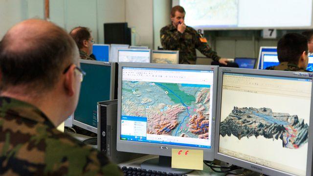 Le système devait permettre de diriger les batailles depuis des écrans d'ordinateur.  [Martin Rütschi - Keystone]