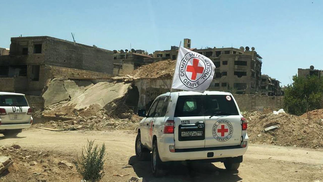 Un convoi d'aide du CICR à Daraya en Syrie. [Keystone]