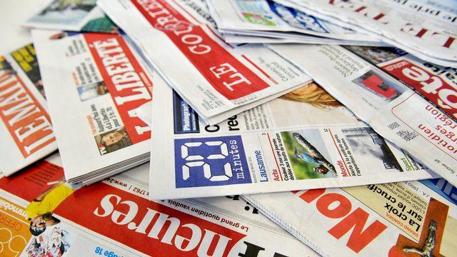 Des journaux et quotidiens de la presse écrite de Suisse romande. [Dominic Favre - Keystone]