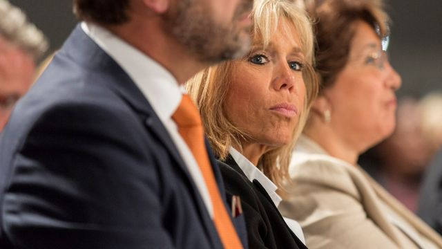 "In this photo dated Tuesday, Oct. 4, 2016 former French Economy Minister and potential French presidential contender Emmanuel Macron's wife Brigitte Trogneux listens during a political rally in Strasbourg, eastern France. Macron is the founder of a political movement called ""En Marche"" (On the Move).  [Jean-Francois Badias - AP Photo]"
