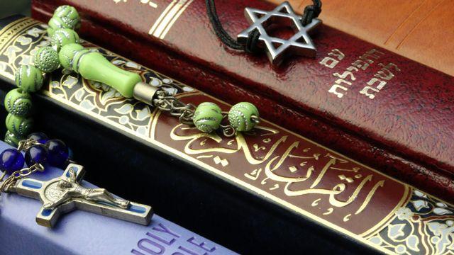 La Bible, le Coran, et la Torah. [AFP]