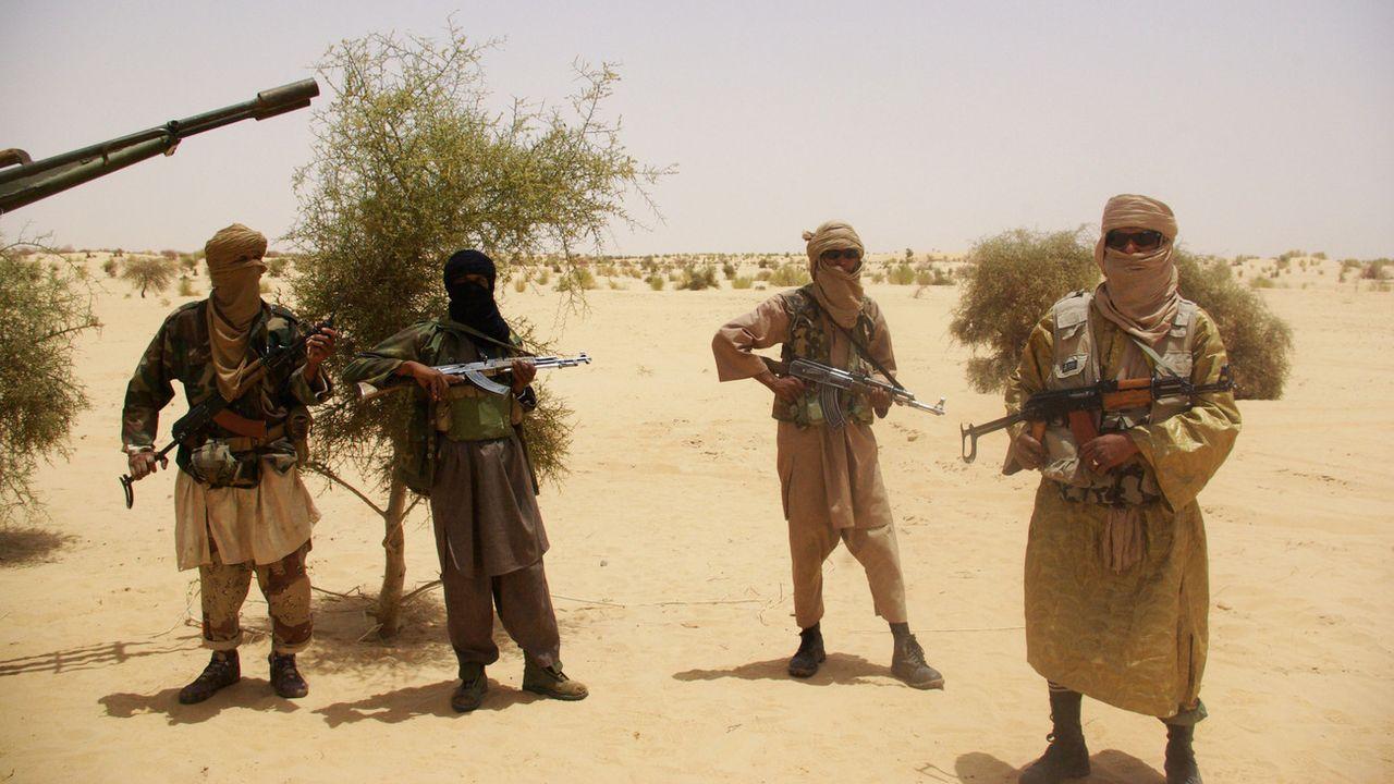 Des combattants du groupe Ansar Dine. [AP Photo - Keystone]