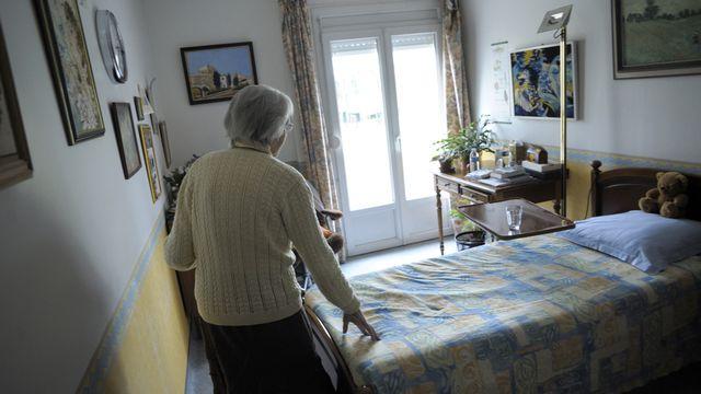 Une femme souffrant de la maladie d'Alzheimer dans un home français. [Sébastien Bozon - afp]