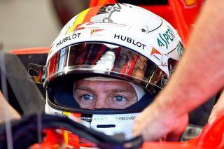 Le pilote de F1 Sebastian Vettel de l'équipe Ferrari. [Zsolt Czegledi - Keystone]