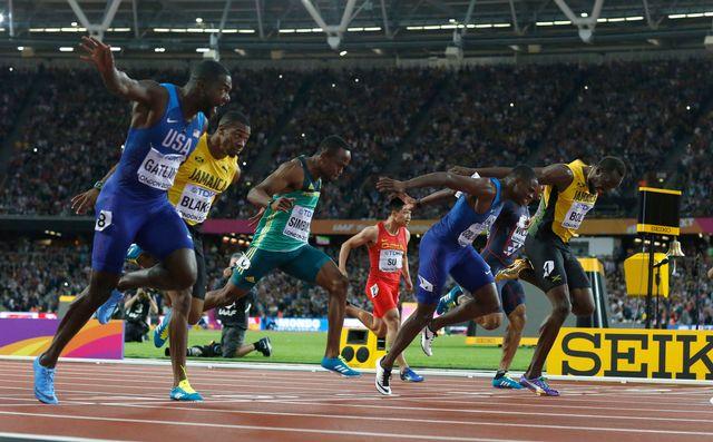 Justin Gatlin (à gauche) a devancé Christian Coleman et Usain Bolt. [Matt Dunham - Keystone]