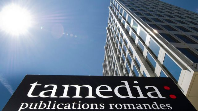 Le logo de Tamedia devant l'ancienne Tour Edipresse, à Lausanne. [Jean-Christophe Bott - Keystone]