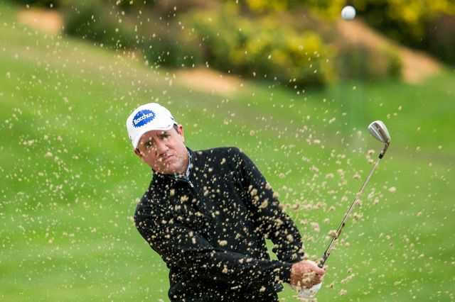 Scott Hend toujours en tête à l'European Masters de Crans-Montana, malgré la météo. [Alexandra Wey - Keystone]