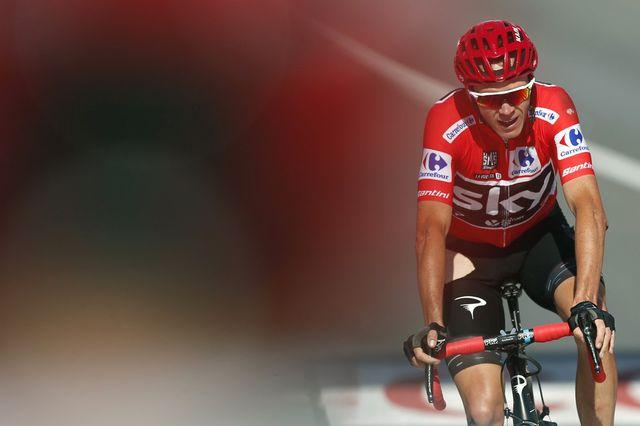 Froome est devenu le 3e coureur à réussir la même saison le doublé Tour de France-Vuelta. [Javier Lizon - Keystone]