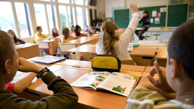 Des élèves dans une école primaire (image d'illustration). [Georgios Kefalas - Keystone]