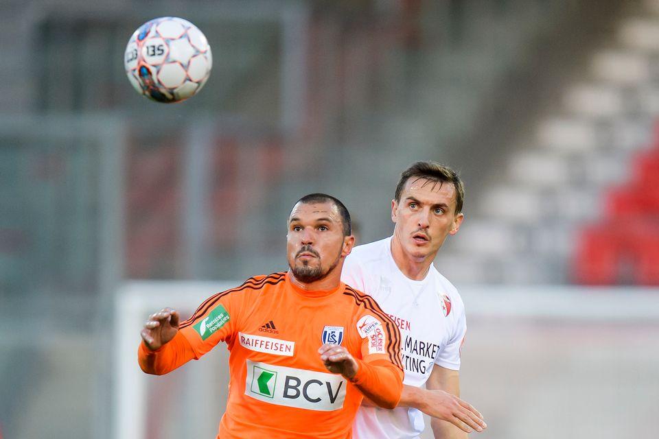 Valeri Bojinov (en orange) a inscrit un but  avec le LS. [Jean-Christophe Bott - Keystone]